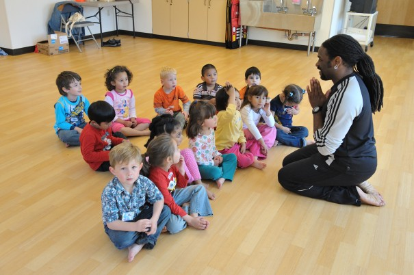 Charles McNeal teaching small children at Holy Family Day Home